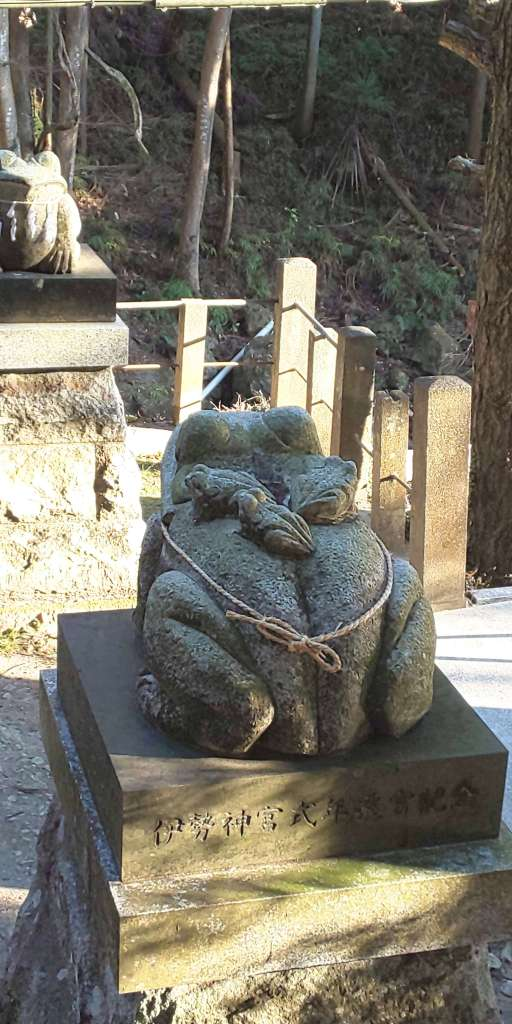 Frog komainu with three babies on her back