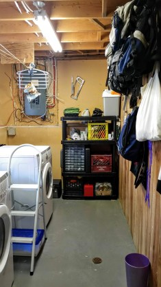 Tool storage and backpacks hung in laundry room