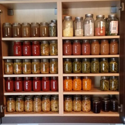Cupboard full of home canned goods.