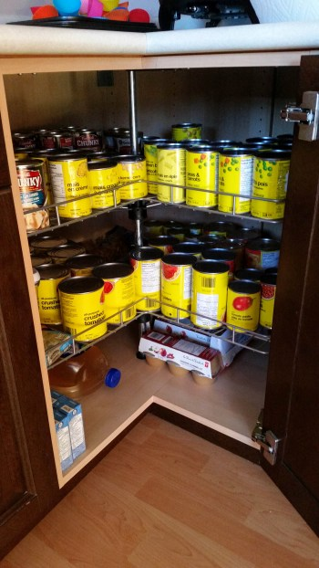 Pantry full of store-bought canned goods.