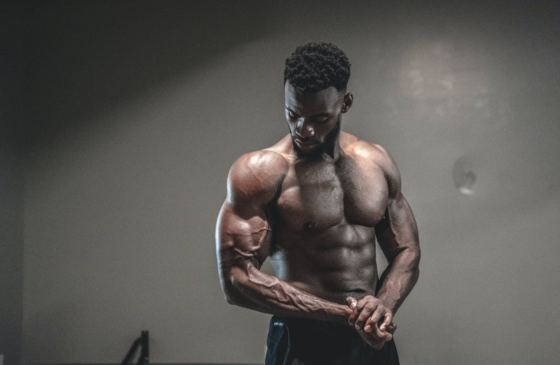 photo of man with muscular body
