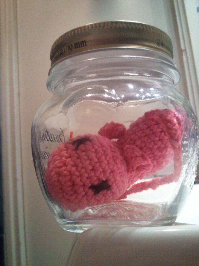 crochet amigurumi fetus in a jar