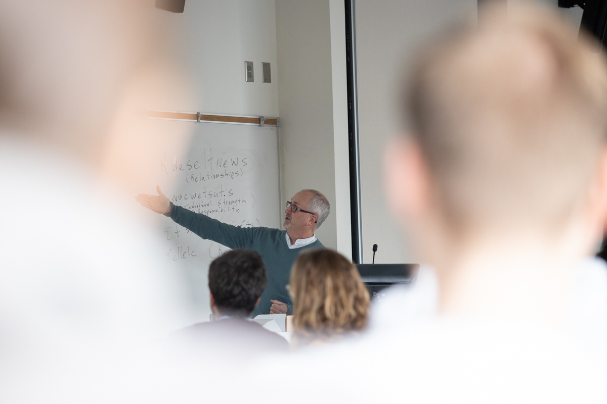 A photograph of faculty member Jeff McLauglin presents at the 2019 PHP Conference.