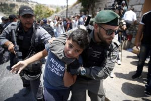 Israeli soldiers arresting a Palestinian child July 2017