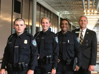 From left to right: Officer Dillon Morgan, Officer Cynthia Wagner, Officer Kelsey Brown, City Manager Tom Tanghe