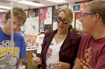 Science teacher with her students