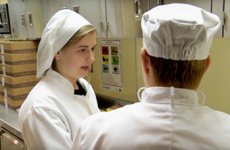 Career Pathways-Two students in Culinary Tech class wearing chef uniforms.