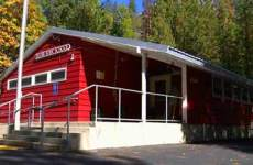 Picture of red one-room schoolhouse in Sliver Fork, CA.