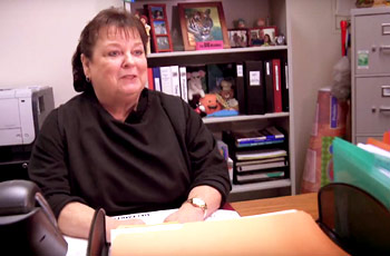 Food Services manager sitting at her desk