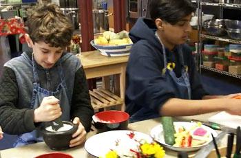 Students preparing food they grew at school.