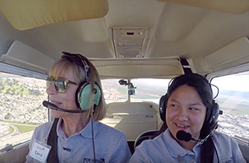 Student and flying instructor in plane.