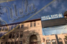 Front entrance of Horace Mann Middle School with a UCLA banner flag overlayed.