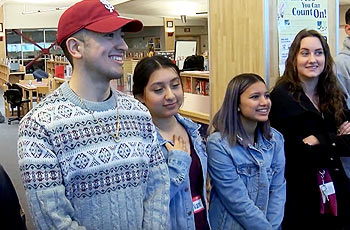 High school students standing in a line smiling