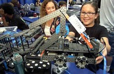 Female student with robotics project in class