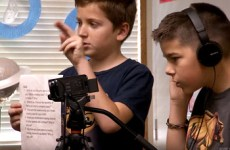 Two media students from Oak Hill Elementary School filming fellow classmates.