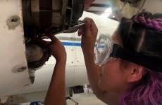 student repairing aircraft