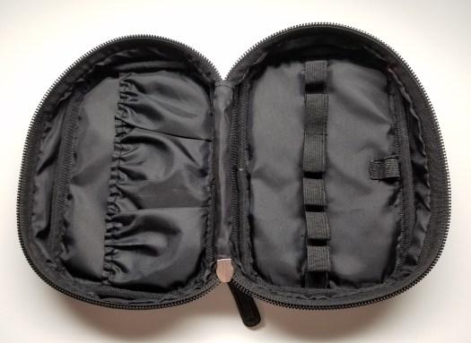 black chanel look cosmetic bag inside