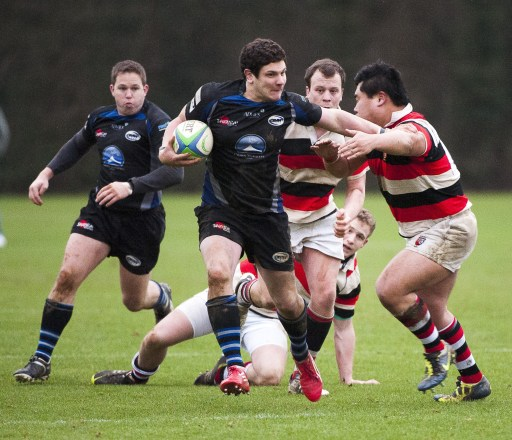 Old Mid-Whitgiftians' centre Andy Dean, supported by fullback James Orchard, powers his way through the Paulines defence. Picture by Peter Filewood