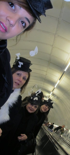 Eliza Rebeiro (left) with Frances Chatelier, and hatmakers Margaret Chatelier and Monique Rebeiro (right) arrive by Tube for Tuesday's New Year's Day Parade in central London