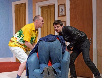 A bit of a farce: Neil O'Gorman, left, Simon Long, right, and Wayne Trice's bottom in the Mitre Players' latest production, together with three of the set's seven doors. Pictures by Charles Marriott
