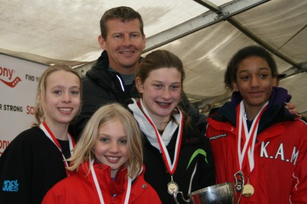 Former world champion Steve Cram presents the Herne Hill under-13 girls' team with their National trophy and medals. The team, from left, is Eloise