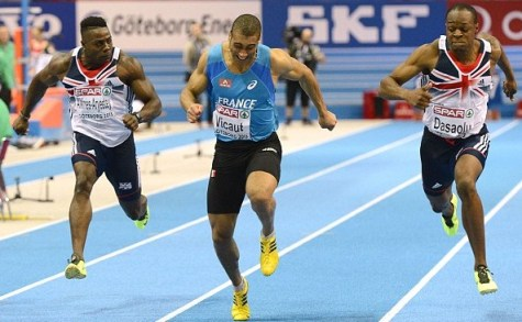 Down to the line: Jimmy Vicaut, centre, and James Dasaolu, right, battle to the line in the European indoor 60m final, where Sutton's Harry Aikines-Ayreety placed seventh