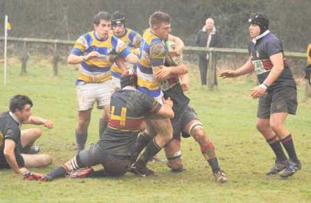 PJF's Liam Miles, supported by Tom White and Tom Leather, force their way through Old Blues's defence