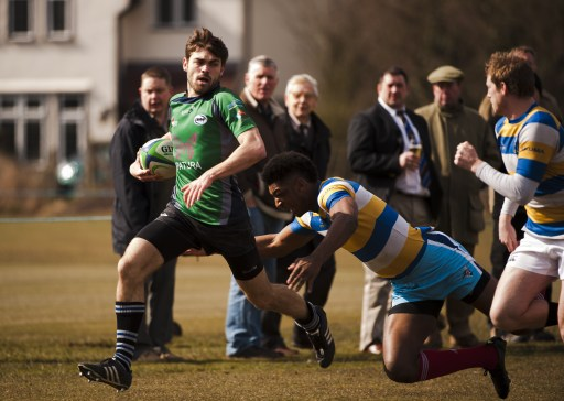 Mid-Whitgiftians' wing Ben Perrett on his way to his side's opening try against local rivals Purley John Fisher last Saturday. Photograph by Peter Filewood