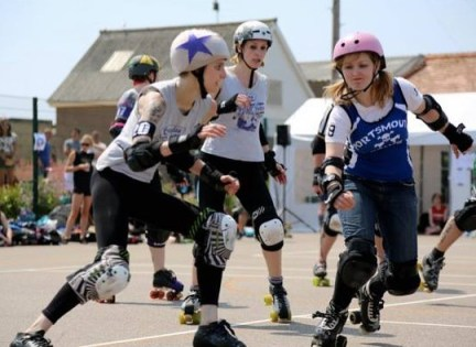 Croydon Roller Derby's President Garfield (left, with star on her helmet) takes on Portsmouth's Malibash Stacey in the recent Eastbourne Extreme. Photographs by Vicky Walters