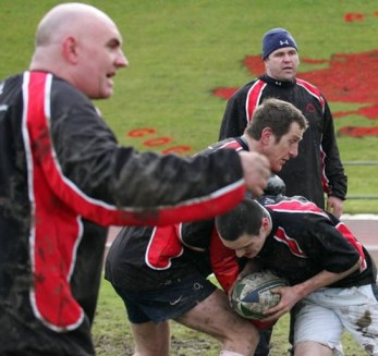 Smashing time: Former England and Lions centre Will Greenwood takes the hit, watched over by his fellow Sky Sports presenter Scott Quinnell, in a SoHK training session