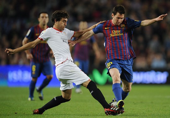 Jose Campana, Palace's new signing, tackling Lionel Messi for Sevilla in La Liga. Will he be effective in the Premier League?
