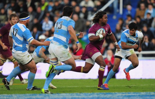 Marland Yarde, in try-scoring action for England against Argentina. He is one of two former Whitgift pupils called up to the England elite squads
