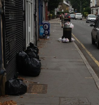 "Here's a grubby street scene on Southbridge Road: while local Tory councillors boast about ""record"" rates of recycling, some flat dwellers simply dump their rubbish on the road. This picture was taken on the afternoon last week after the regular rubbish collection"