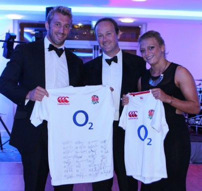 Chris Robshaw, the England captain (left), and Kelly Wilsonat last week's Warlingham ball, where they donated autographed England shirts to help raise funds for the club's apprenticeship scheme