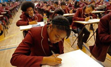 """Pupils at Harris Academy South Norwood sitting their public exams: but what happened to so many of their """"disappeared"""" year group?"""