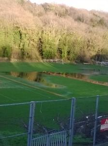 The cricket ground at Kenley looked saturated with floodwater on Friday afternoon