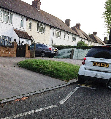 Close enough? The council vehicle, not content with parking on double yellow, is almost on a zebra crossing zig-zag, too