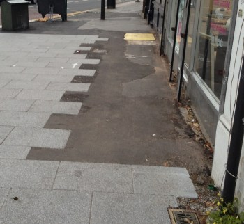 Unfinished, perhaps, but some of the paving along the pavements on South End looks well below standard, or has much work to do