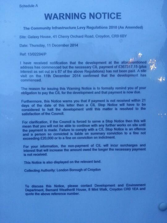 The council's warning notice pinned to the entrance to the Menta Redrow site, forbidding any further work