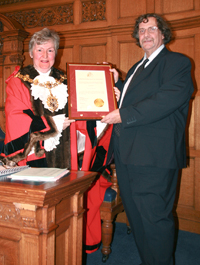 Ian Austen, right, receives his long-service award from the 2009 Croydon Mayor, Margaret Mead