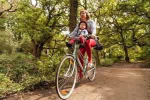 Riding bicycles in parks allows parents to teach children how to be safe when cycling