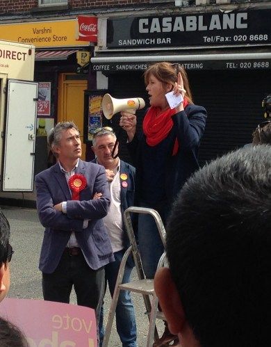 Getting their message across: Sarah Jones addresses her Labour rally yesterday, watched by Steve Coogan