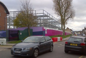 The new Oasis academy at Croydon Arena takes shape, its steel skeleton already dominating residential Albert Road