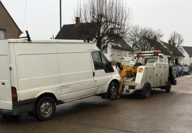 Heading for the dump: one of the offenders' vans gets towed away