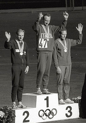 Paul Nihill, left, receives his Olympic silver medal at the 1964 Olympics in Tokyo