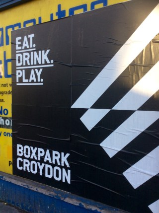 Whoops: Boxpark's poster has been splattered across a shop front which Croydon Council wants to re-open as a trendy art gallery next month