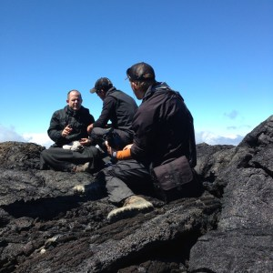 Father Nathan working with camera crew on Mauna Loa