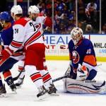 Carolina Hurricanes Brad Malone and Patrick Brown screen NY Islanders Goaltender Chad Johnson. (Brandon Titus/Inside Hockey)