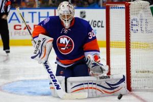 NY Islanders Goaltender Chad Johnson makes a pad save.(Brandon Titus/Inside Hockey)