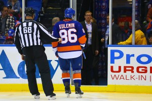 Nikolai Kulemin gets escorted off the ice following a game misconduct  (Brandon Titus/Inside Hockey)